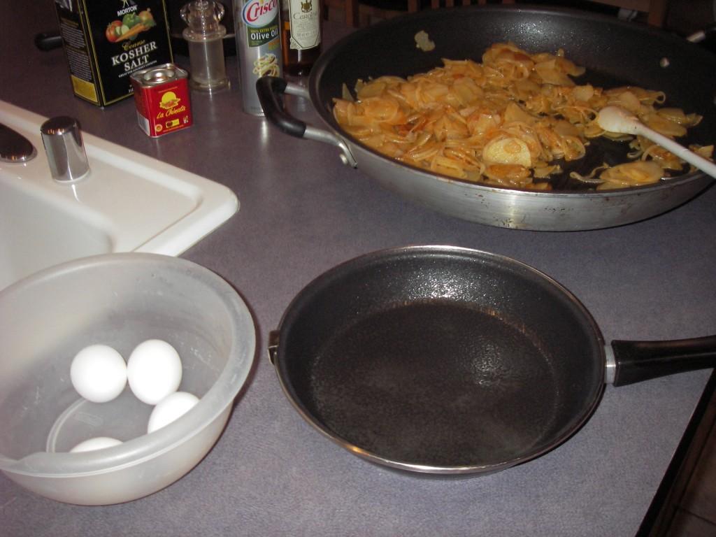 Tortilla Espanola cooking potatoes