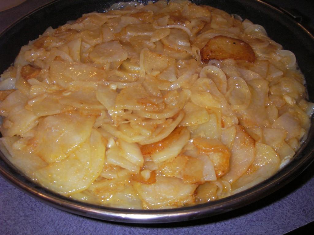Tortilla Espanola potatoes, onions, and eggs mixed